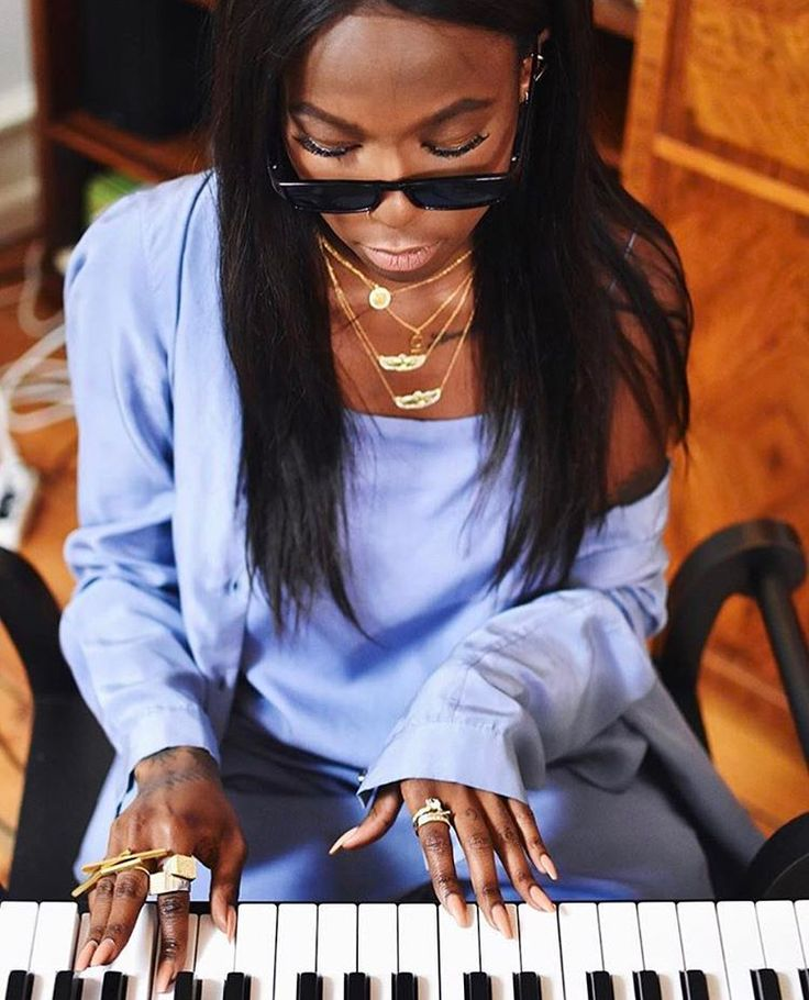 The cool Swedish singer Sabina Ddumba is showing off her Novello Piazza Signet Rings.