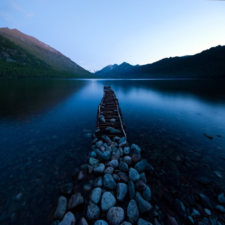 Disappearing under the water | mountains, lake, stones, wooden pier