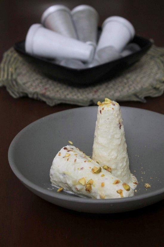 Malai Kulfi Recipe with step by step photos - It is an Indian frozen dessert made from whole milk, heavy cream, khoya, sugar and chopped nuts.