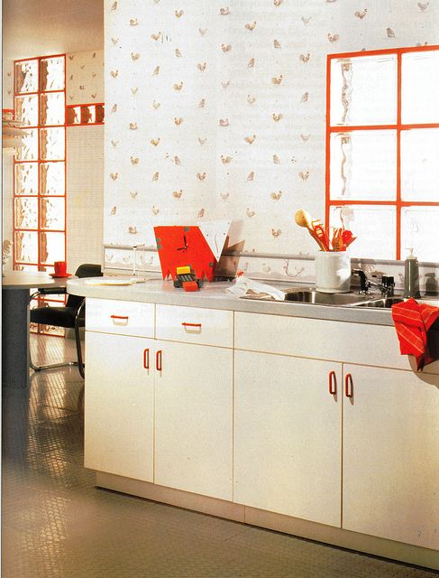1980s kitchen in white and red. Another example of the regimented, geometric style present. Though it has some element of 'modern', it seems quite harsh and uninviting.