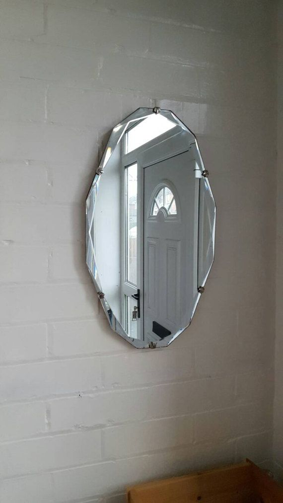 Gorgeous vintage frameless oval mirror bevelled scalloped edges clam shell detail original chain wooden back.  Measures approx:- 55cms x 33cms International shipping prices are available upon request. Please provide a postcode and city for a quote.