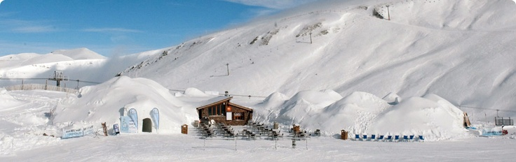 Igloo Hotel in Andorra.  Take a break from skiing with a cup of hot wine and take a tour of this awesome igloo hotel.