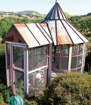 An old feed bin can be turned into a beautiful aviary ~ for rescues     http://www.motherearthnews.com