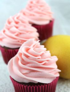 The Best Pink Lemonade Frosting - our delicious buttercream frosting infused with the refreshing flavor of Pink Lemonade. Light and fresh and creamy with the perfect amount of tartness, this yummy homemade butter cream frosting will take your Spring or Summer dessert to the next level, we promise! Pin this tasty Pink Lemonade Icing for later and follow us for more great Frosting Recipes!