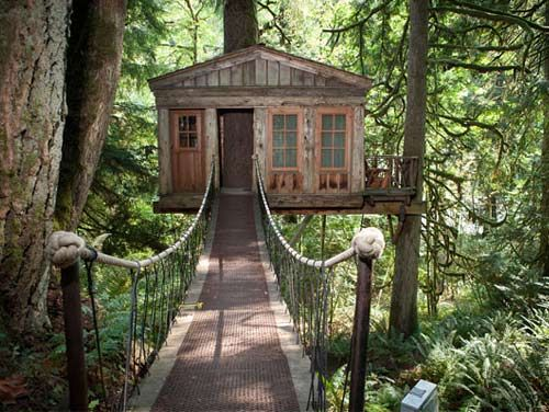 "At TreeHouse Point in Issaquah, Washington, you get from cabin to cabin by walking across breathtaking suspension bridges, shown here outside the ""Temple of the Blue Moon"". ($150 to $215 per night)"