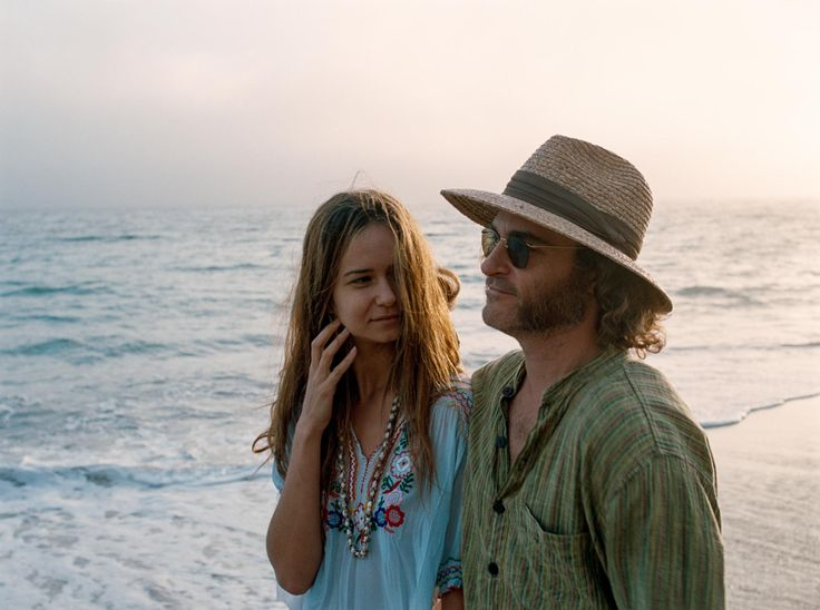 "Katherine Waterson as Shasta Fay and Joaquin Phoenix as Doc in ""Inherent Vice."""