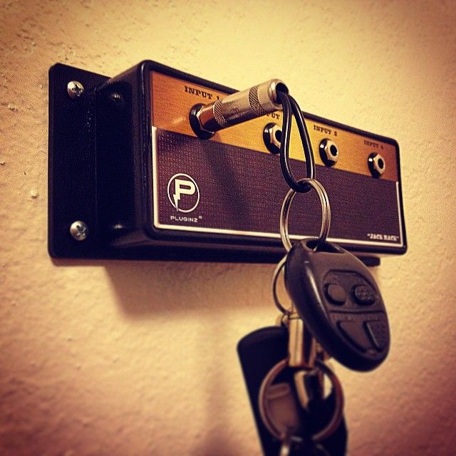 Miniature amps use audio input jacks to cleverly hang keys. #decor