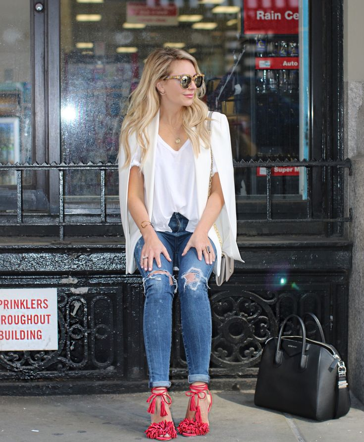 Time to get ready for New York Fashion Week! White tee shirt and blazer. Distressed denim and red fringe heels