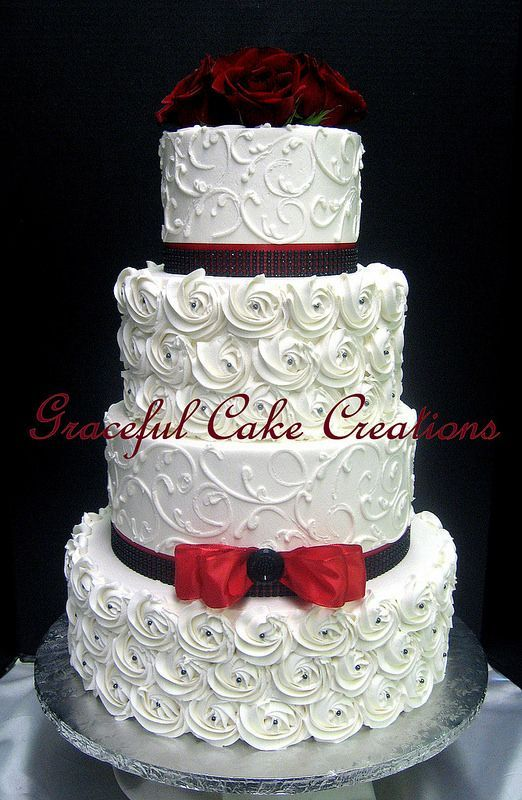 Elegant White Butter Cream Wedding Cake With Piped Rosettes And Scrolls Decorated Red Ribbon
