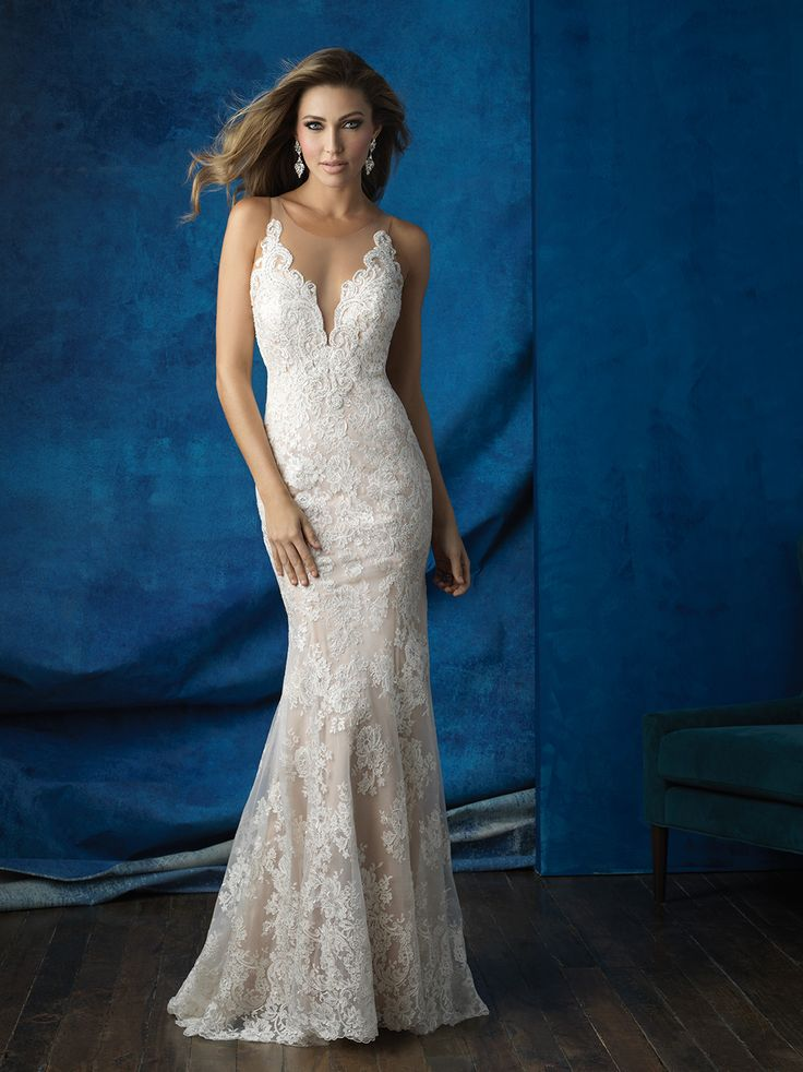 Sheer illusion netting creates an ethereal silhouette at the neckline and back of this lace sheath // Allure Bridals 9363