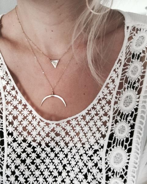 See all layered styles-  'Amaris' necklace + 'Double Horn' necklace. Click to shop.