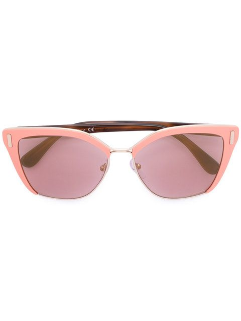 Shop Prada Eyewear cat eye sunglasses.