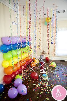 Colorful Photo Backdrop with Balloons and Garlands - 13 Inventive DIY Photo Backdrop Tutorials. I think this balloon backdrop is perfect for a toddler birthday party.