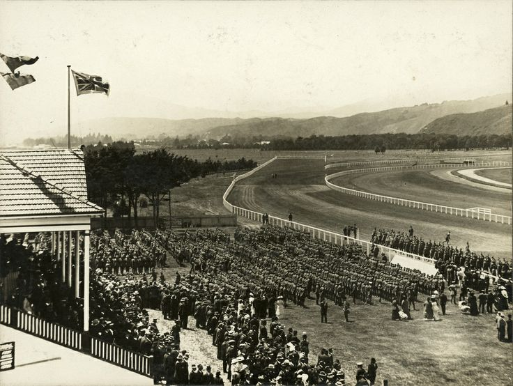 Trentham racecourse, ca. 1914; troops assembled in front of the main stand. [P3-457-1718] | Upper Hutt City Library