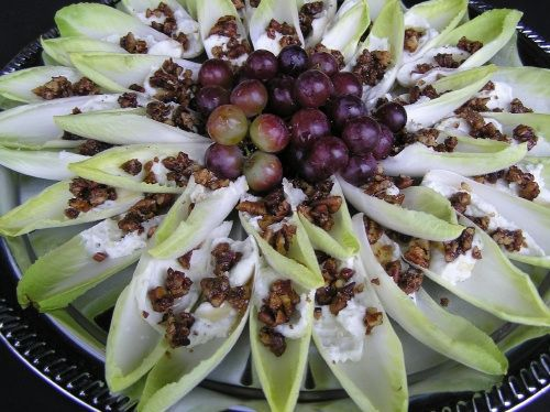 A lighter, healthier (and very pretty) appetizer: Belgian endive leaves with a blue cheese/cream cheese spread, topped with caramelized pecans.