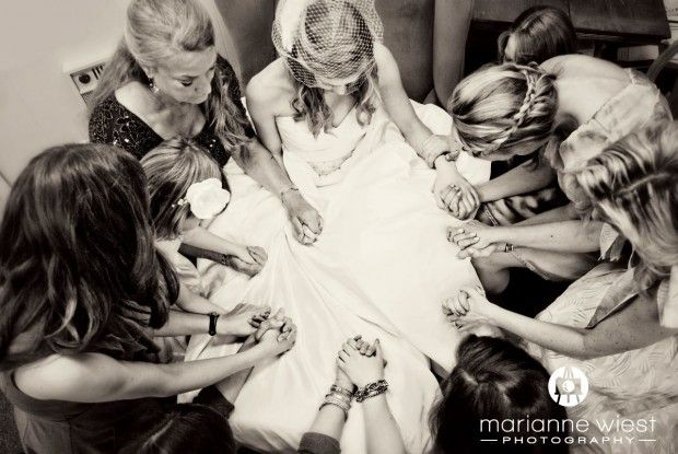 I love how they bride, bridesmades and moms are praying together