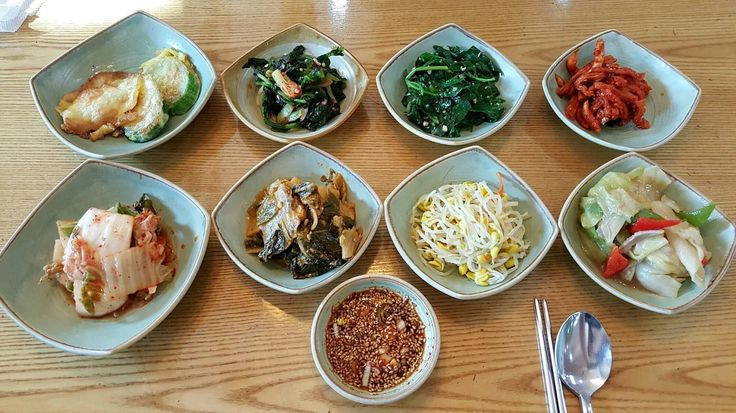 Photo: 반찬, Banchan Korean side dish, banchan is served. Which one do you like most from here? Ok, let's see the name of it one by one.  From the left upper corner to clock wide direction, 전[jeon], Korean style of pancake 열무김치[yeolmu gimchi], Young radish kimchi 시금치무침[sigeumchi muchim], Seasoned spinach 무말랭이[mumallangyi], Dried radish kimchi  Lower line 김치[gimchi], Kimchi 김치볶음[gimchi bokkum], stir-fried kimchi 콩나물무침[kongnamul muchim], Seasoned bean sprout 양배추무침[yangbaechu muchim], Seasoned…