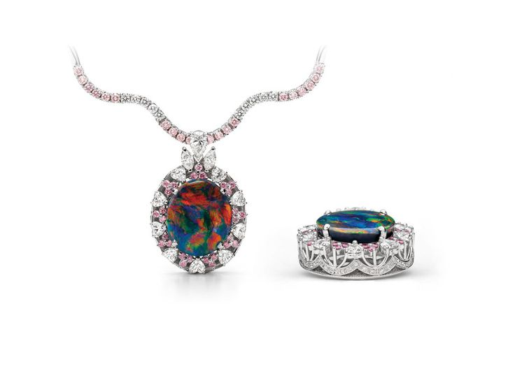 Rare black Australian opal pendant . The opal has multi-colored fire including rare red. The setting around the opal features exceptionally rare Australian Argyle pink diamonds