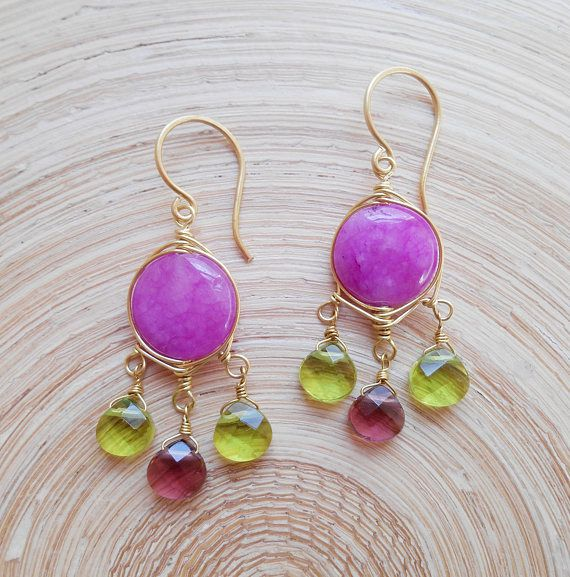 Elegant, cheerful and ultra-feminine, these earrings add a dash of welcome, vibrant color to your outfits. The focal element of the composition is a a lovely violet smooth coin jade bead, which I wire wrapped with gold filled wire and I suspended from its bottom two spring green
