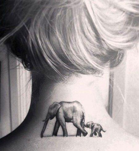 Deux éléphants tatoués sur la nuque