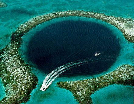 The Great Blue Hole is a large submarine sinkhole off the coast of Belize. It lies near the center of Lighthouse Reef, a small atoll 70 km (43 mi) from the mainland and Belize City. The hole is circular in shape, over 300 m (984 ft) across and 124 m (407 ft) deep.[1] It was formed during several episodes of quaternary glaciation when sea levels were much lower.