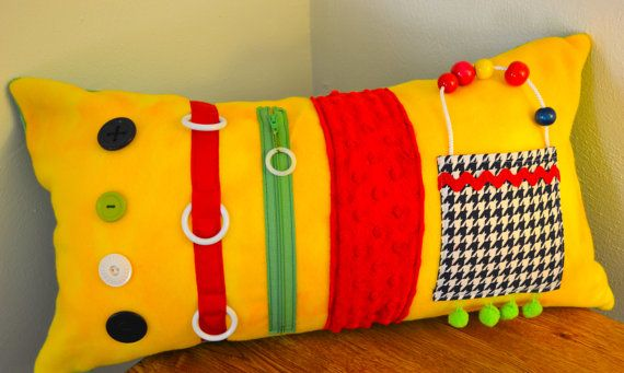Yellow Activity Pillow from Memory Lane Sewing.  Sensory stimulation for those in mid to late stages of Alzheimer's.