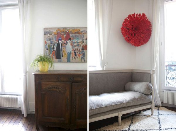 oh happy day's paris apartment.   little grey couch, soft rug, white curtains & fun pop of orange.
