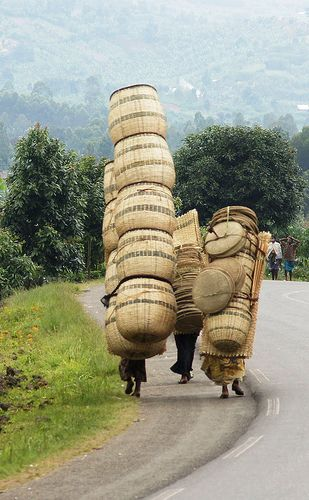 Women carry baskets to market in Rwanda. The number you can carry depends on a good ability to balance!