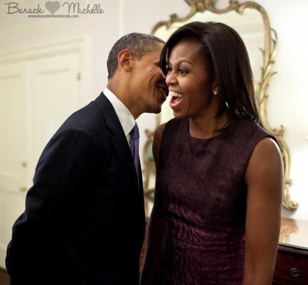 Barack And Michelle Obama  ...Kinda makes you wonder what he's whispering...