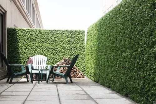 What a brilliant idea! Some creative thinker has come up with artificial hedges to create private outdoor spaces.