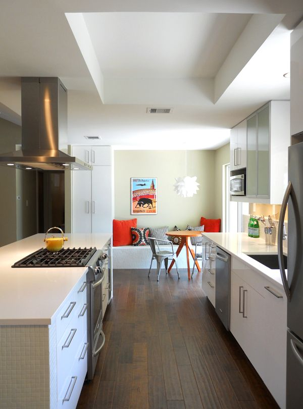 Customized IKEA Kitchen With A Tiled Island Ledge And Dining Bench