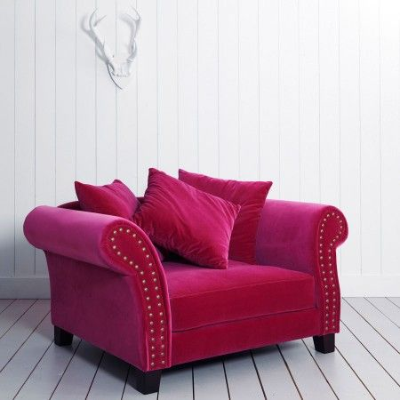 Absolutely in love with this velvet oversize chair in raspberry red pink