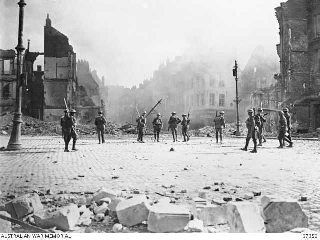 Cambrai, France, 1917. Canadian Army troops entering the centre of the town just after the German Army had retreated. Most of the visible damage was caused by German mines and fires. Later in the day the Germans shelled the town.