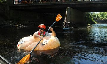 Farmer Paddles Down River In Giant, Hollowed-Out Pumpkin