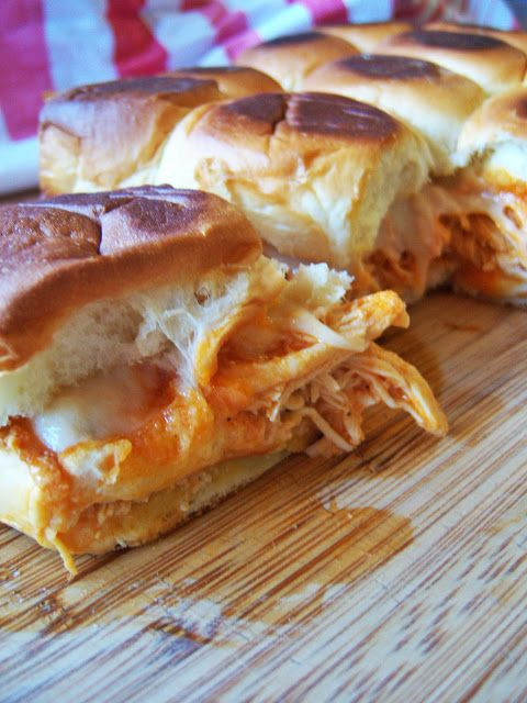 Crockpot Buffalo Chicken Sliders -- boneless chicken breasts, buffalo sauce, ranch seasoning, hawaiian sweet rolls, swiss cheese