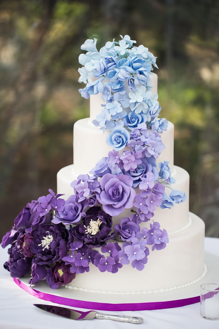 """""""Renowned cake baker Ana Parzych worked with us to design the most magnificent—and best tasting—cake our guests had ever seen, featuring handmade sugar flowers cascading down four tiers in an ombre theme of blues and purples,"""" Lisa says. """"Each tier had a different flavor combination, and each guest had the chance to taste all three."""""""