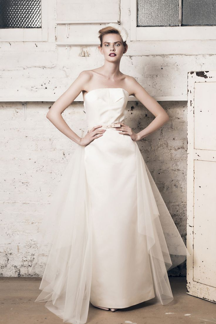 Modern wedding dress for the contemporary bride. Taylor dress, Rosamund train. Strapless silk duchess dress, with pencil skirt, back slit and boned bodice. Tulle train.