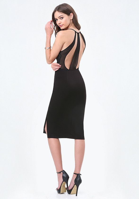 Sophisticated cocktail dress with back illusion detailing. Double side slits and…