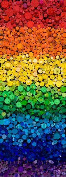"""""""Chasing Rainbows"""" by Jeffrey Scott Lewis, 28"""" x 72""""  Plastic bottle caps on Canvas.  2009"""