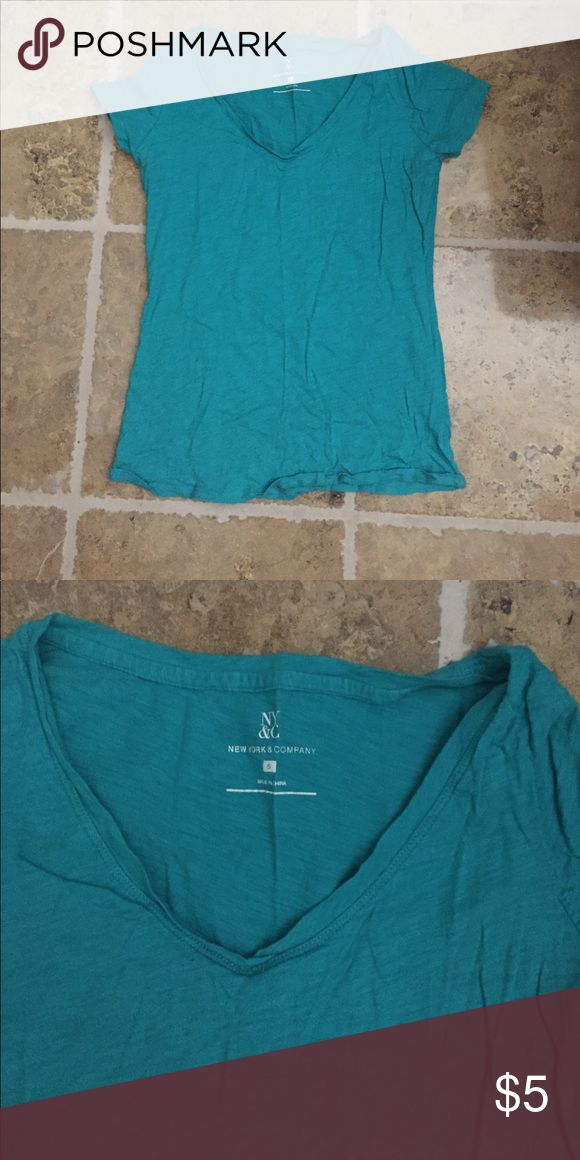 Turquoise Short Sleeve Shirt Super cute. Awesome color. Goes with jeans or shorts. New York & Company Tops Tees - Short Sleeve