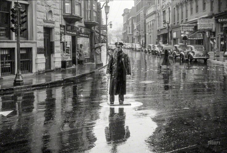 Street scene on a rainy day in Norwich, Connecticut. 1940, by Jack Delano.