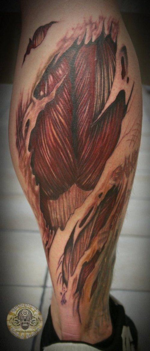 Ripped Skin Biomechanical Tattoo On Right Leg