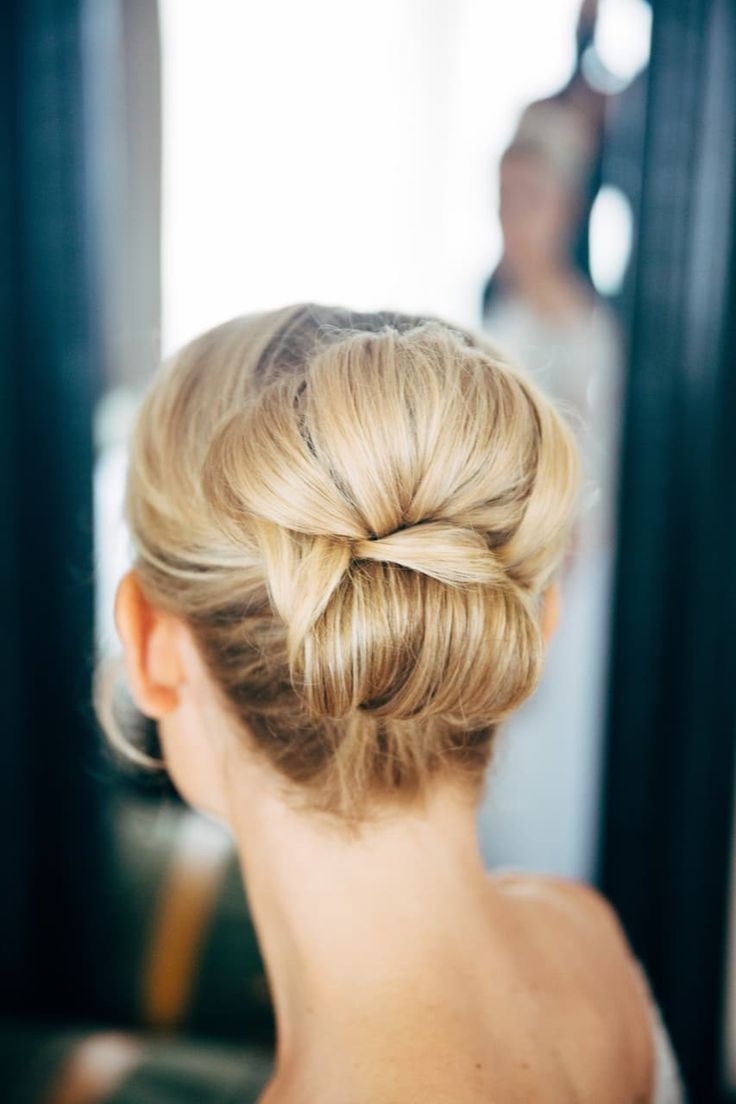 A simple yet elegant up-do for this bride's low stress wedding.