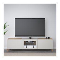 BESTÅ Meuble télé avec tiroirs et porte, effet noyer teinté gris Lappviken, gris clair verre clair - 180x40x48 cm - glissière tiroir, fermeture silence - IKEA