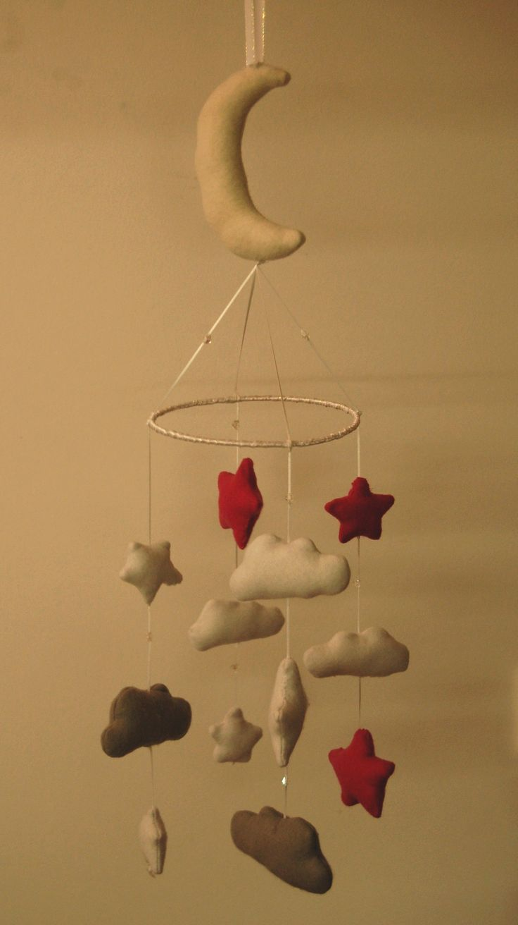 Baby mobile with a felt moon, stars and clouds