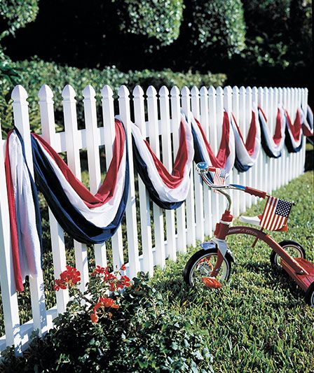 What's more American than a white picket fence?.... A white picket fence with the colors of the American Flag! And a radio flyer tricycle