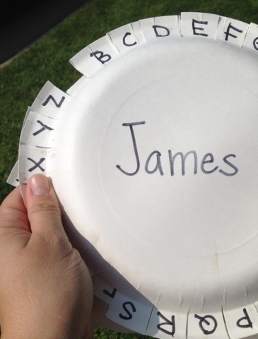Letter Walk - make this letter wheel out of a paper plate and then walk around the neighborhood looking for letters on signs, license plates, and utility boxes. Whenever you find one of the letters, fold it down on the plate.