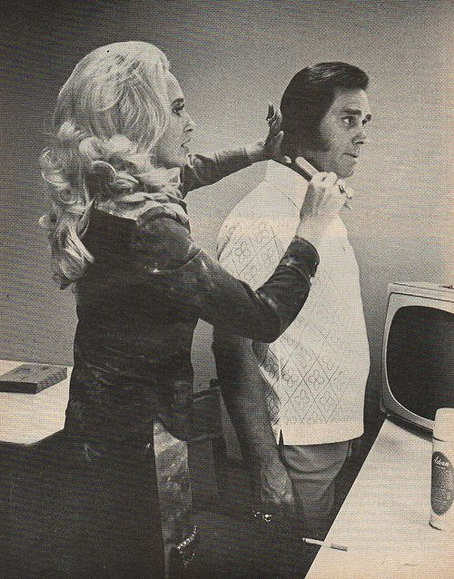 Tammy Wynette, an ex-beautician, gives George Jones a final comb before taking the Grand Ole Opry stage.