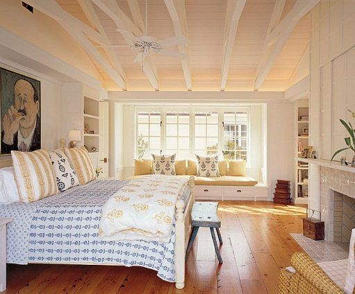 Bare floors and quilted fabrics give the bedroom a casual feel.