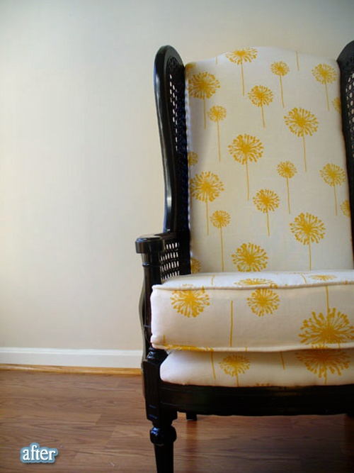Black caned chair with the bright fabric.